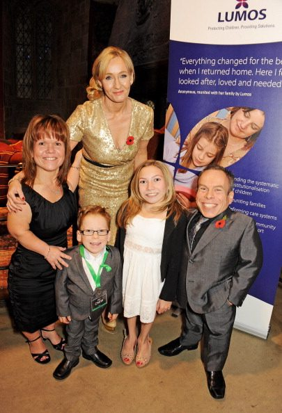 LONDON, ENGLAND - NOVEMBER 09: J.K. Rowling (2L) poses with Samantha Davis, Harrison Davis, Annabel Davis and Warwick Davis at the Lumos fundraising event hosted by J.K. Rowling at The Warner Bros. Harry Potter Tour on November 9, 2013 in London, England. (Photo by David M. Benett/Getty Images for Lumos)